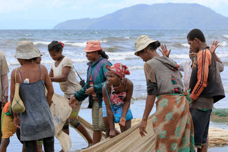 destitution: MAROANTSETRA, MADAGASCAR OCTOBER 19.2016 Native fishermen fishing on sea, using traditional technique pulling net from boat. Life of indigenous peoples in countryside. October 19. 2016, Madagascar