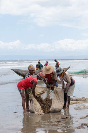 MAROANTSETRA, MADAGASCAR OCTOBER 19.2016 Native fishermen fishing on sea, using traditional technique pulling net from boat. Life of indigenous peoples in countryside. October 19. 2016, Madagascar