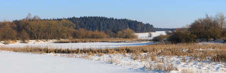 panorama of Beautiful winter rural landscape with frozen small pond. Czech beautiful highland vysocina european countryside