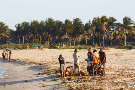 TOAMASINA, MADAGASCAR OCTOBER 17.2016: Malagasy peoples resting on the beach in harbor in the second largest city of Madagascar. In October 17. 2016, Toamasina, Madagascar