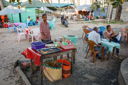 penury: TOAMASINA, MADAGASCAR - OCTOBER 17, 2016: street stall with fast food in second largest city Toamasina. Ordinary street life in Toamasina, Madagascar October 17. 2016