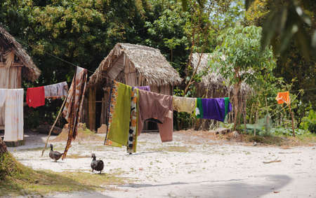 Traditional african malagasy huts in Maroantsetra region, typical village in north east Madagascar, Masoala national park, Toamasina Province.
