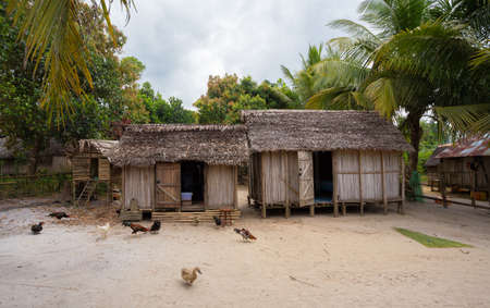 Traditional african malagasy hut in Maroantsetra region, typical village in north east Madagascar in Masoala national park, Toamasina Province.