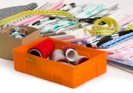 cotton fabric material, tailor measurement tape with scissors and spools of thread cotton