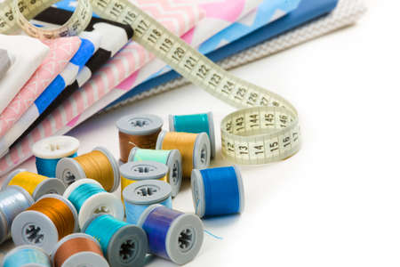 cotton fabric material, tailor measurement tape with spools of thread cotton