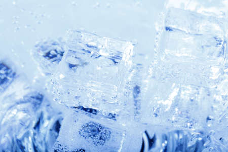 Abstract blue backgrounds with ice cubes in sparkling water