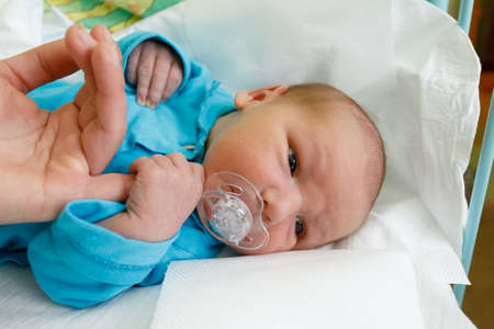 newborn baby infant in the hospital, the first hours of the new life, one days after birth Stock Photo