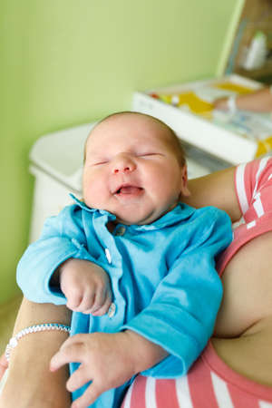 miraculous: newborn baby infant in the hospital, the first hours of the new life, one days after birth Stock Photo