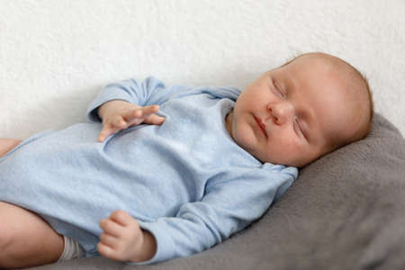 sleeping newborn baby - the first month of the new life Stock Photo