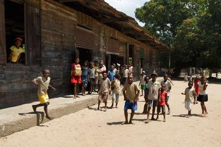 MADAGASCAR OCTOBER 17.2016: Malagasy children students behind old school, Maroantsetra - Andranofotsy, October 20. 2016, Madagascar