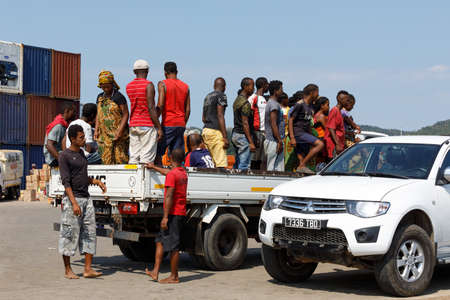 NOSY BE ,MADAGASCAR - NOVEMBER 3.2016 Traditional Malagasy peoples car transport. Many peoples in one crowded car in Nosy Be port. Nosy be, Madagascar, November 3. 2016 Editorial