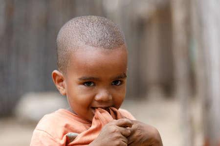 NOSY BE ,MADAGASCAR - NOVEMBER 3.2016 Malagasy young boy in street of Nosy Be city. Nosy be, Madagascar, November 3. 2016