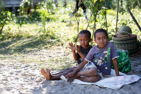 MADAGASCAR OCTOBER 23.2016 Countriside malagasy children from village sititng and resting in shadow. Countriside Madagascar celebration scene. October 23. 2016, Madagascar.