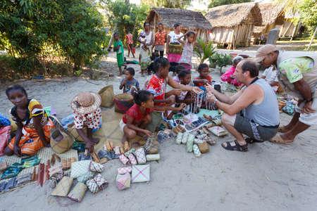 MAROANTSETRA, MADAGASCAR OCTOBER 23.2016 Malagasy woman from village selling traditional souvenir village street. Madagascar countryside scene. Maroantsetra, Madagascar October 23. 2016 Editorial