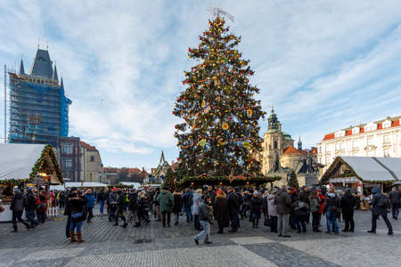 PRAGUE, CZECH REPUBLIC - DECEMBER 9, 2017: Peoples on the famous advent Christmas market at Old Town Square with christmas tree in Prague. It is very popular destination with tourists visiting Prague. December 9, 2017 Prague, Czech Republic. Redakční