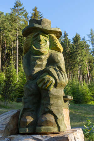 wooden Sculpture of Vodyanoy  waterman (Vodnik) on small pond