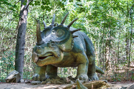 Big model of prehistoric dinosaur styracosaurus in nature. Realistic scenery.