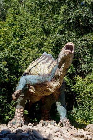 Big model of prehistoric dinosaur in nature. Realistic scenery.