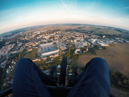 Powered paragliding tandem flight, point of view to ground