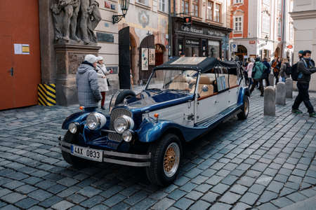 PRAGUE, CZECH REPUBLIC - DECEMBER 8, 2018: Famous historic car Praga at street in advent christmas time. Praga is a manufacturing company founded in 1907 in Prague. December 8, 2018 Prague, Czech Republic.