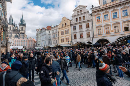 PRAGUE, CZECH REPUBLIC - DECEMBER 8, 2018: Peoples on the famous advent Christmas market at Old Town Square with christmas tree in Prague. It is very popular destination with tourists visiting Prague. December 8, 2018 Prague, Czech Republic.