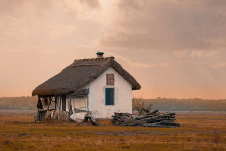 sunset over house of shepherds in Hortobagy National Park, Hungary, puszta is famous ecosystems in Europe