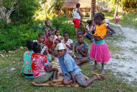 Maroantsetra, Madagascar - November 23 2016: Malagasy childrens enjoing at football match behind his village, near Masoala rainforest in Madagascar.