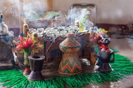 Traditional cup of Ethiopian coffee served with aromatic essence. Ceremony with Incense, usually frankincense and myrrh ignited by a hot coal to produce smoke that carries away any bad spirits. Ethiopia, Africa Stockfoto