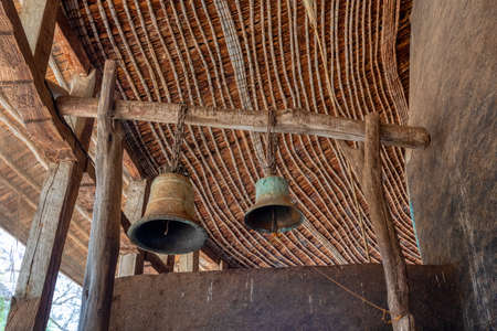 Zege Peninsula in Lake Tana. Ceremonial bells in UNESCO Ura Kidane Mehret Church, monastery from 14th century by the saint Betre Mariyam, decorated with painted frescoes 스톡 콘텐츠