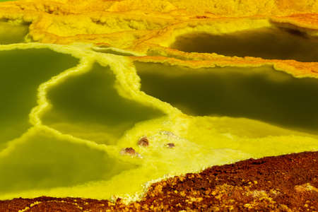 Beautiful small sulfur lakes Dallol, Ethiopia. Danakil Depression is the hottest place on Earth in terms of year-round average temperatures. It is also one of the lowest places on the planet