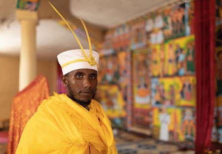 Bahir Dar, Ethiopia - April 21, 2019: Orthodox monk serving worship in Tana Haik Entons Eysus United Monastery on lake Tana near Bahir Dar. Ethiopia Africa