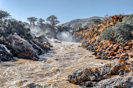 beautiful Epupa Falls on the Kunene River in Northern Namibia and Southern Angola border. Sunrise sunlight in water mist. This is africa. Beautiful landscape.