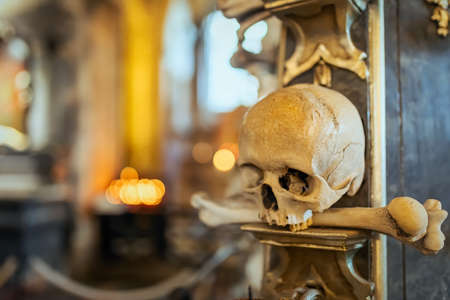 Human skulls and bones Kostnice Sedlec Ossuary, small Roman Catholic chapel, Cemetery Church of All Saints in Sedlec, a suburb of Kutna Hora in the Czech Republic. UNESCO world heritage site
