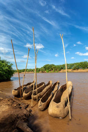 traditional wooden coarse boat on mystical Omo river. Omo valley, Omorati Etiopia