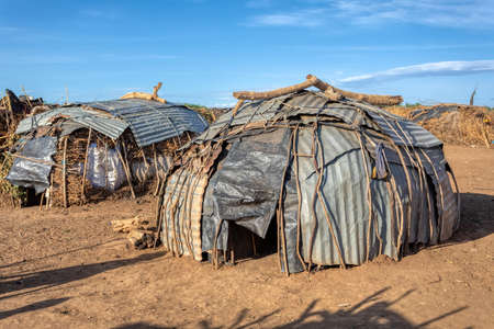 Poor huts in traditional african Dassanech village, Omo river, Ethiopia indigenous people houses