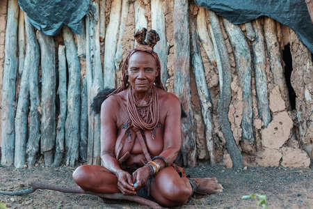 NAMIBIA, OMUSATI REGION, MAY 6: Grandmother Himba woman with traditional hairstyle and necklaces around her neck. The Himba are indigenous namibian people, in northern Namibia, May 6, 2018, Namibia