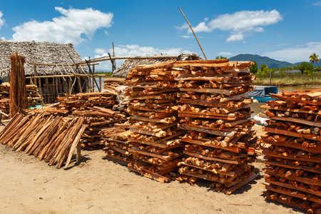 sale of firewood on street marketplace in Maroantsetra city, Madagascar. Deforestation is big problem.