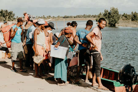 MADAGASCAR OCTOBER 18.2016 Malagasy people wait for transport by taxi boat. Daily life on the river. Maroantsetra October 18. 2016, Madagascar. Editorial