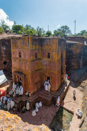 LALIBELA, ETHIOPIA, MAY 1st. 2019, Orthodox Christian Ethiopian people, believers in front of famous rock-hewn St. George's Church after Mass on May 1st. 2019 in Lalibela, Ethiopia
