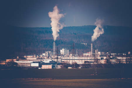 industrial cityscape with with smoking factory, ecology and pollution concept Stock Photo
