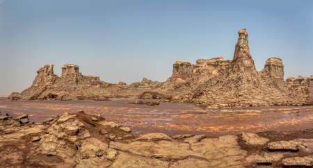 High rock formations rise in the Danakil depression like stone rock city. Landscape like Moonscape, Danakil depression, Ethiopia, Africa Stock Photo