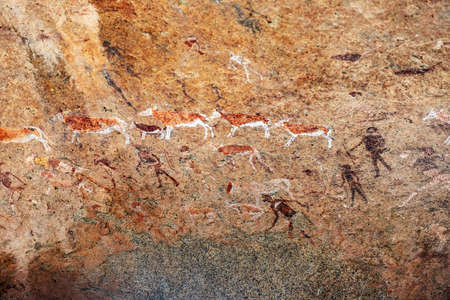 Bushmen rock paintings White Lady in Brandberg mountain area in Namibia. A spiritual site of great significance to the San (Bushman) tribes. Prehistoric archeological sign.