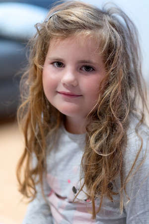 Portrait of a cute little Caucasian girl child with disheveled hair. Imagens