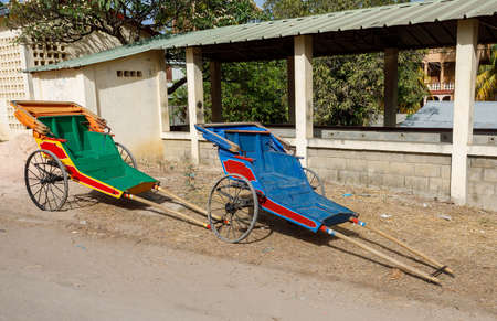 Pulled rickshaw in the street of north Madagascar. Human-powered rickshaws is a mode of transport in many countries.