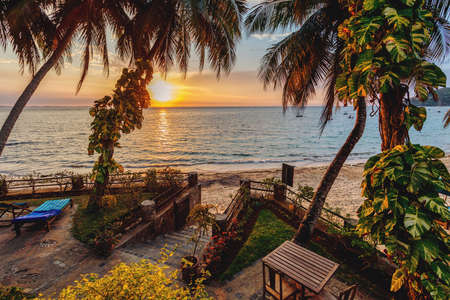 view of Nosy Be paradise beach in dusk sunset, in background turquoise sea. North Madagascar. Africa vacation travel concept