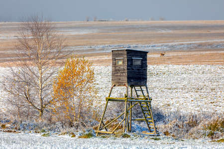Wooden Hunters hunting tower in countryside landscape covered by frost, Winter snowy season, Czech Republic, Highland, European Scenery Banco de Imagens