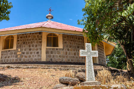 religious christian cross behind Entos Eyesu Monastery situated on small island on lake Tana near Bahir Dar. Ethiopia Africa