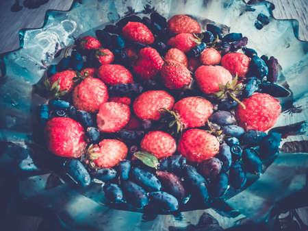 strawberries and honeysuckle Stok Fotoğraf