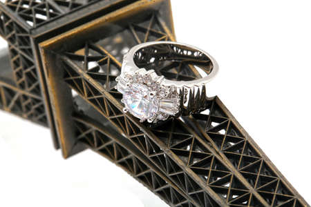 silver jewelry: Diamond silver ring on eiffel tower. Jewelry background Stock Photo