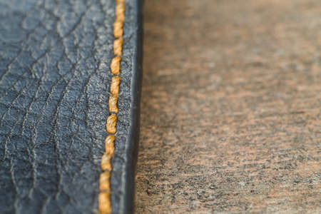 seam: macro skin with a seam on a wooden surface Stock Photo